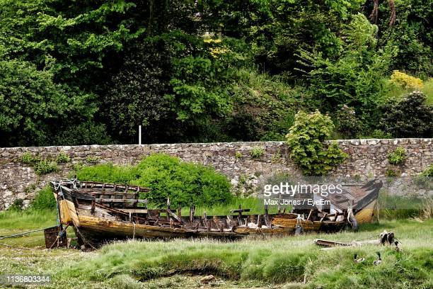 Abandoned Boat On Field