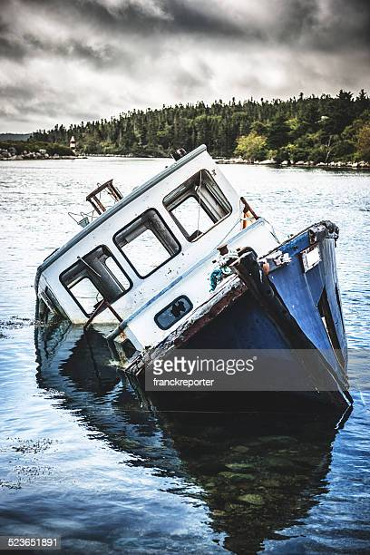 abandoned boat on the nova scotia landscape - sunken stock pictures, royalty-free photos & images