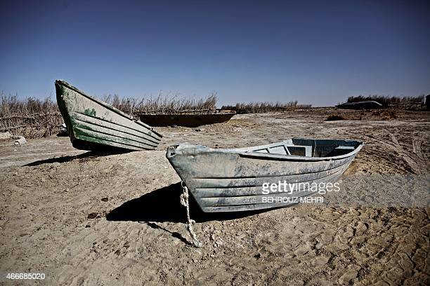 Abandoned boats in Sikh Sar village at Hamoon wetland near the Zabol town in southeastern province of SistanBaluchistan bordering Afghanistan on...