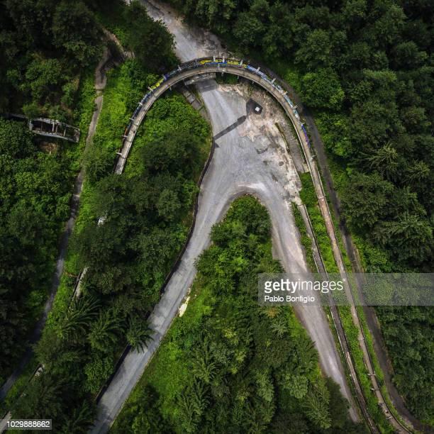 abandoned bobsled track in sarajevo, bosnia herzegovia - bobsledding stock pictures, royalty-free photos & images