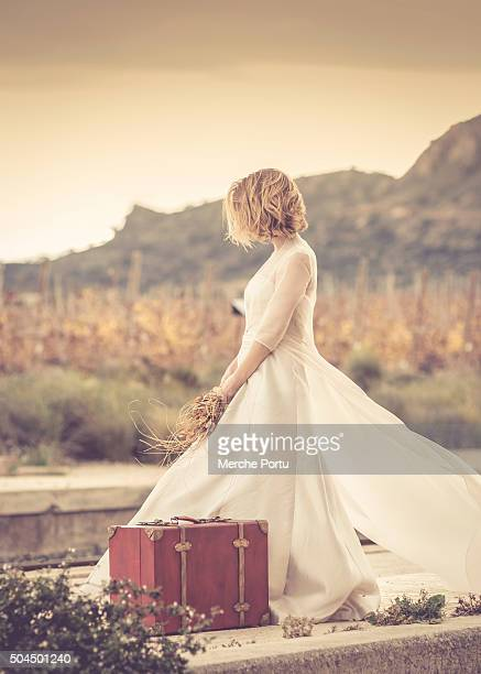 Abandoned bride with a suitcase