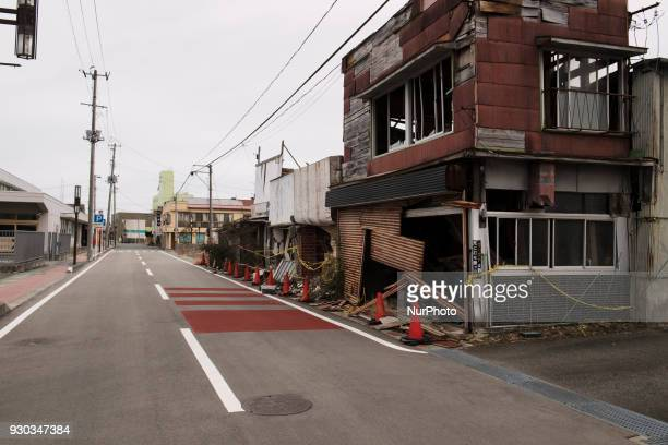 Abandoned broken houses line along the deserted street at Namie town in Fukushima prefecture 11 March 2018 Seven years have passed since the Great...