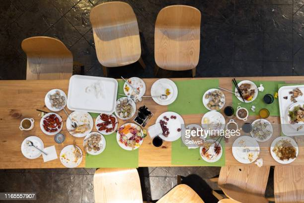 abandoned buffet dinner table after eating - leftovers stock pictures, royalty-free photos & images
