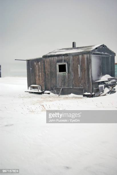 abandoned building against clear sky during winter - barrow alaska stock pictures, royalty-free photos & images
