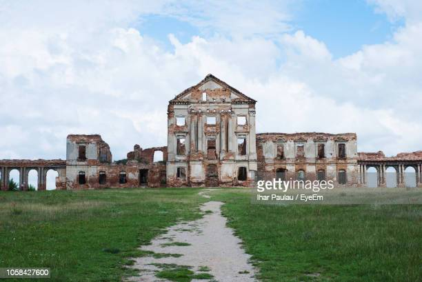 abandoned building against cloudy sky - run down stock pictures, royalty-free photos & images