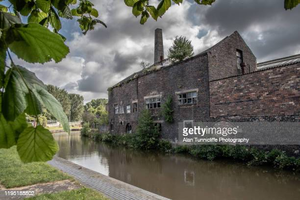 abandoned building by a canal - stoke on trent stock pictures, royalty-free photos & images