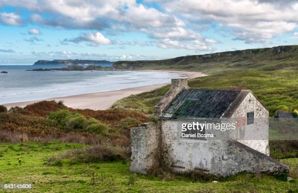 Abandoned building overlooking the beautiful White Park Bay in Northern Ireland