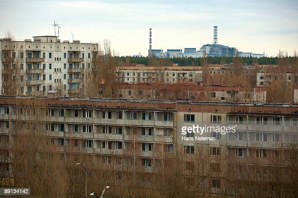 Abandoned buildings with a power station in the background, Chernobyl Power Plant, Chernobyl, Ukraine