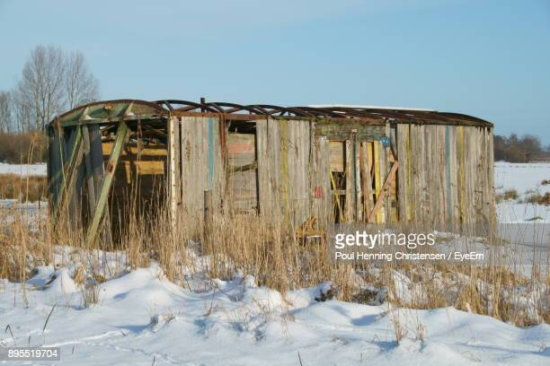 Abandoned Built Structure On Snow Field Against Clear Sky