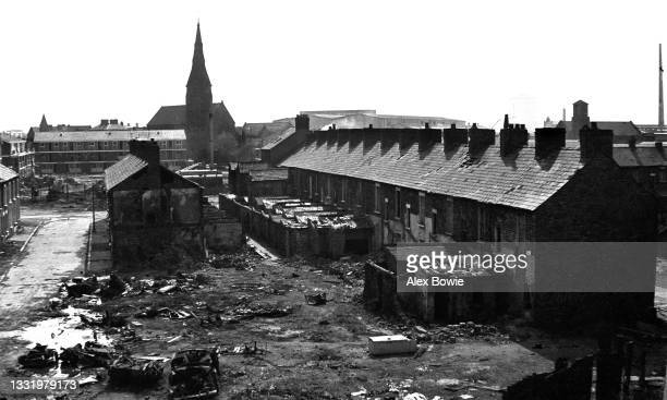 Abandoned by people fleeing sectarian violence, Victorian-era terraced houses await demolition and redevelopment in the Protestant Ballymacarrett...