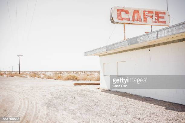 Abandoned cafe on rural dirt road
