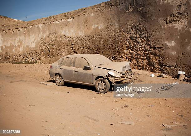 abandoned car, essaouira, morocco - car crash wall stock pictures, royalty-free photos & images
