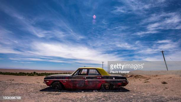 abandoned car in atacama - abandoned car stock photos and pictures