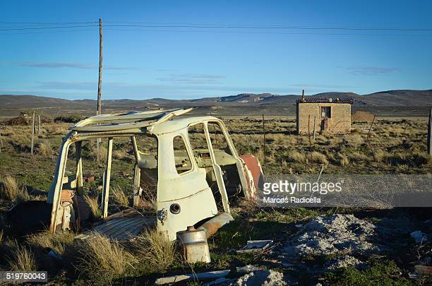 abandoned car in patagonian landscape - radicella stock pictures, royalty-free photos & images