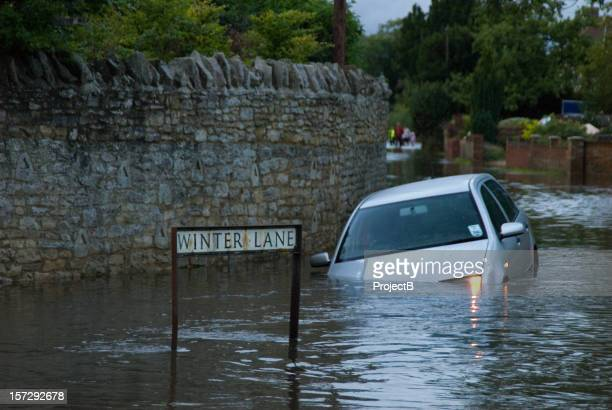 abandoned car in rural flooding - flooding stock photos and pictures