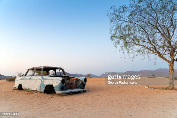 abandoned car in the desert - abandoned stock pictures, royalty-free photos & images
