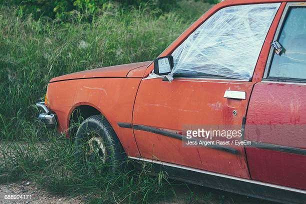 Abandoned Car On Grassy Field