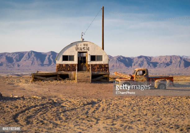 abandoned car wreck in the desert - rusty old car stock pictures, royalty-free photos & images