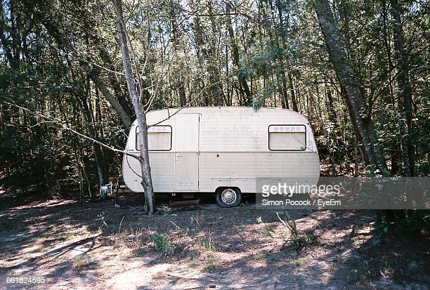 Abandoned Caravan In Forest