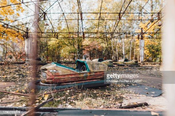 abandoned carnival fair with bumper cars in chernobyl - chernobyl stock pictures, royalty-free photos & images