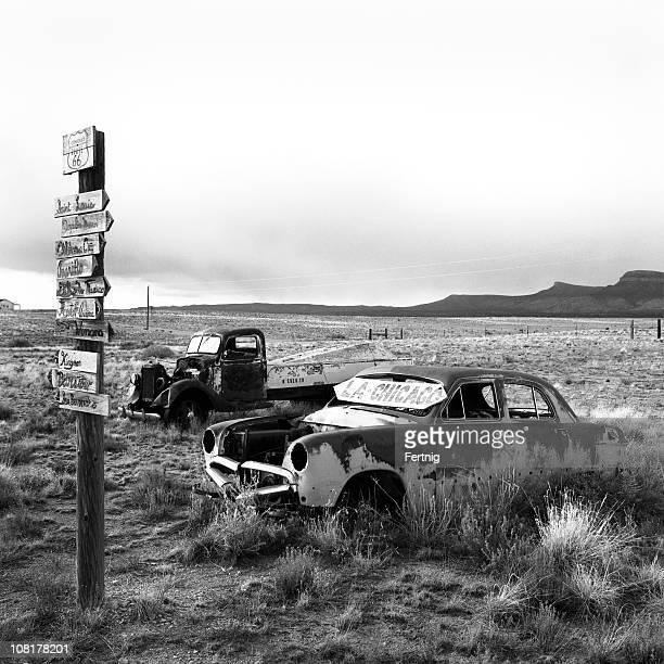 Abandoned Cars in Desert Field, Black and White