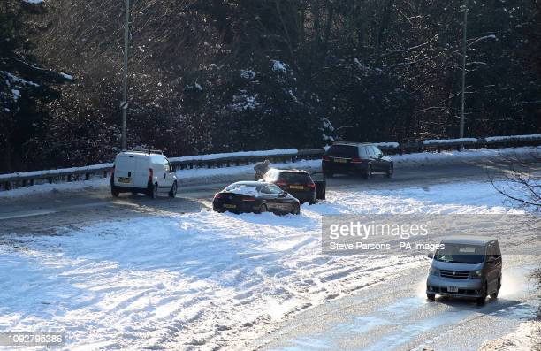 Abandoned cars on the A30 in Basingstoke after snowfalls yesterday and overnight are expected to bring widespread disruption.