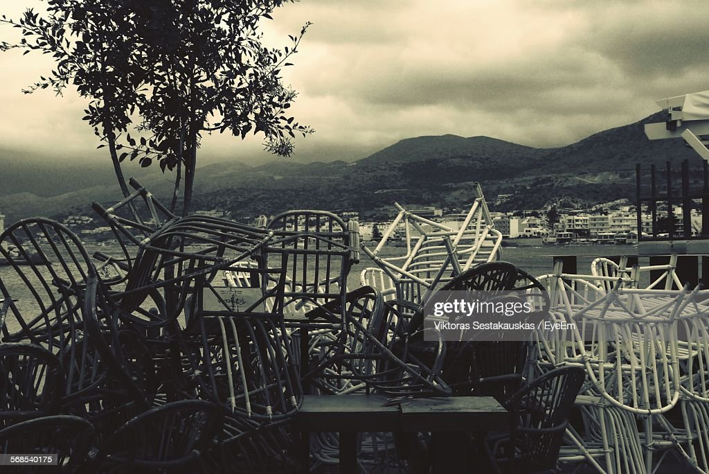 Abandoned Chairs Against Cloudy Sky : Stock Photo