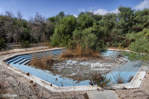 abandoned children's pool at zeytineli beach on a sunny autumn day. - emreturanphoto stock pictures, royalty-free photos & images