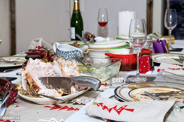 abandoned christmas dinner table after eating - leftovers stock pictures, royalty-free photos & images