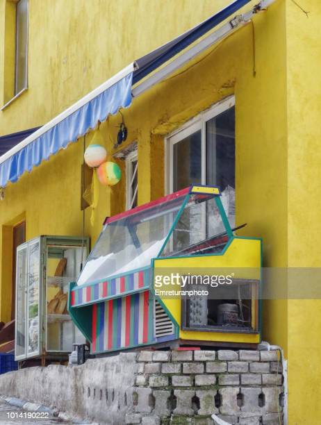 abandoned colorful refrigerated cabinet in front of a market in payamli village. - emreturanphoto stock-fotos und bilder