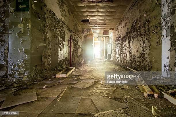 abandoned corridor in the chernobyl exclusion zone, pripyat, ukraine - chernobyl stock pictures, royalty-free photos & images