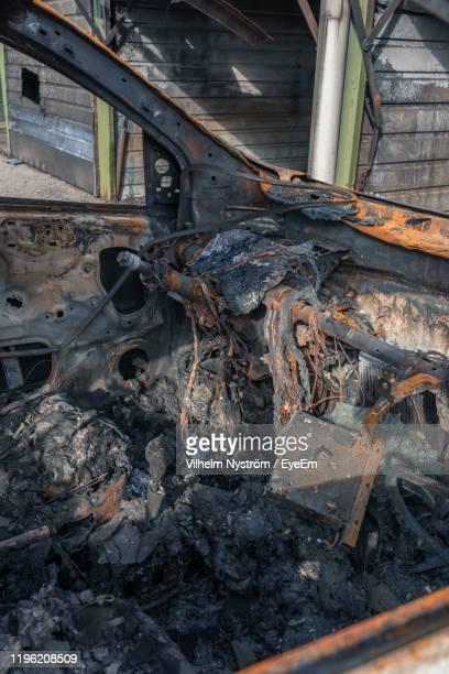 abandoned damaged car outdoors - vanda stock pictures, royalty-free photos & images