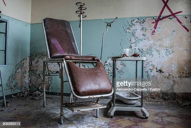Abandoned Dentist Chair In Clinic
