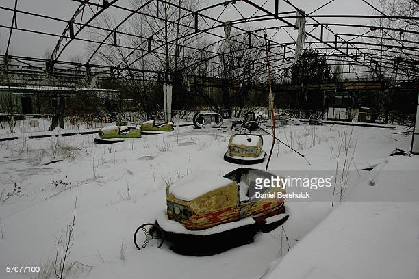 Abandoned dodgem cars are seen in a childrens' fairground in the town of Pripyat on January 29 2006 near Chernobyl Ukraine The town of Pripyat...