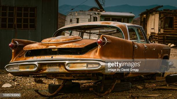 abandoned dream car - junkyard stock photos and pictures