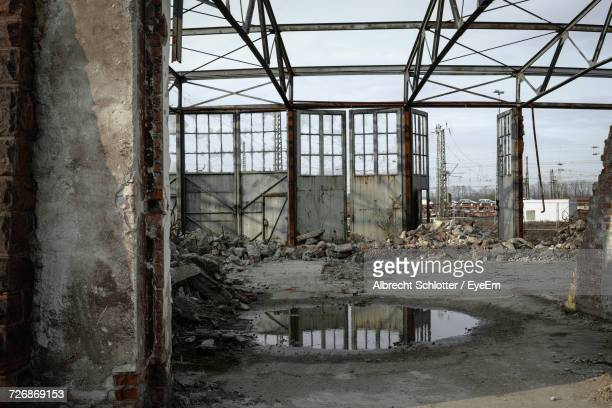 abandoned factory against sky - albrecht schlotter stock photos and pictures