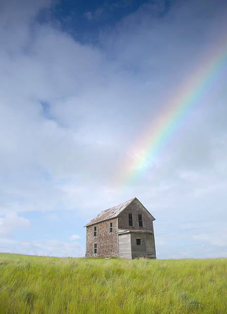 Abandoned Farmhouse With A Rainbow Above It Wall Art