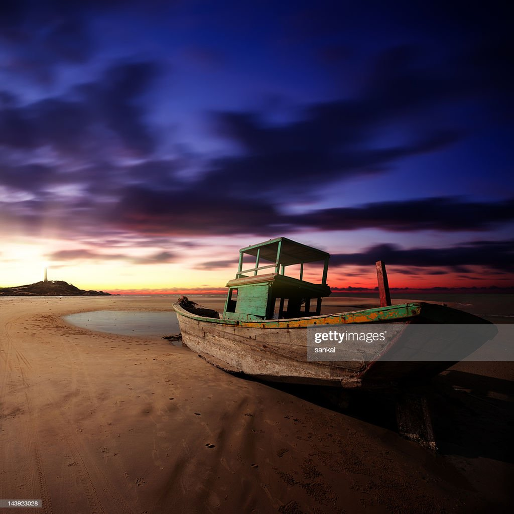 Abandoned Fishing Boat On The Beach At Sunrise High-Res