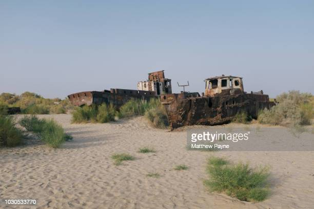 Abandoned fishing boats in the dry seabed of Aral Sea, Uzbekistan