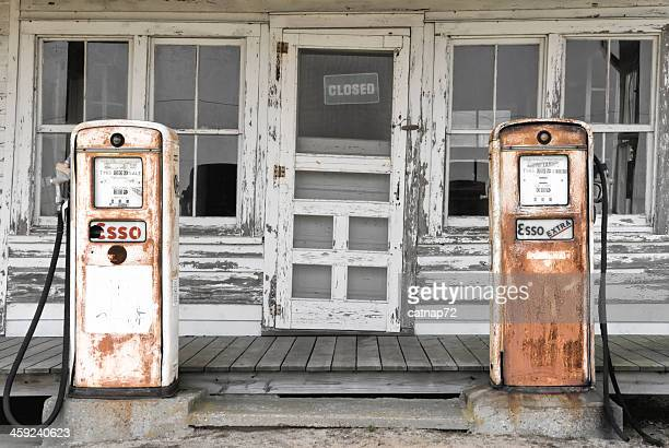abandoned gas pumps at a country store - abandoned stock photos and pictures