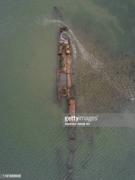 abandoned german u-boat at high tide, river medway, united kingdom - submarine photos stock pictures, royalty-free photos & images