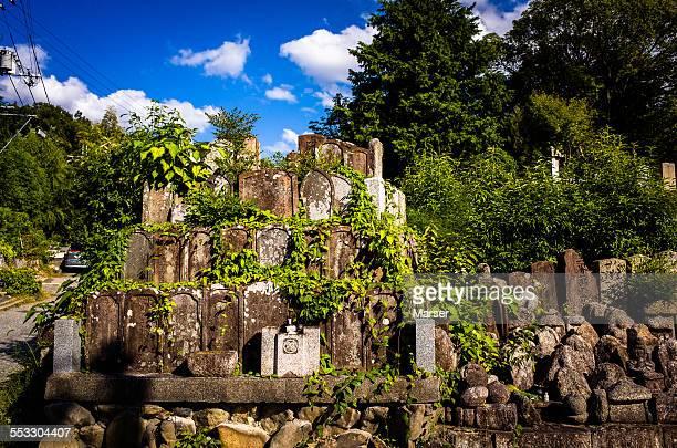 abandoned gravestones on a fine day - 墓地 ストックフォトと画像