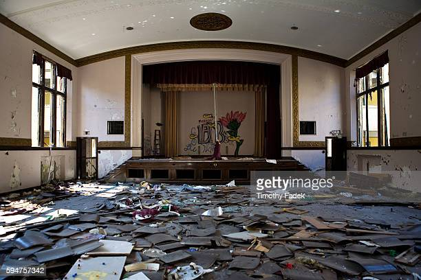 Abandoned High School auditorium The decadeslong decline of the US automobile industry is acutely reflected in the urban decay of Detroit the city...