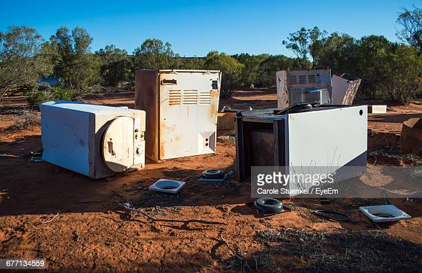 Abandoned Home Appliances On Field Against Sky