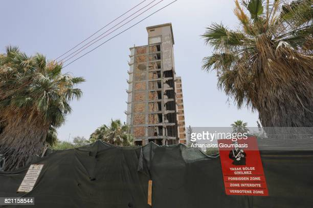 Abandoned hotel building stand beyond a makeshift barrier inside the 'Forbidden Zone' of Varosha district on July 11, 2017 in Famagusta, Cyprus....
