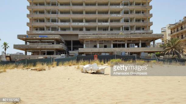 Abandoned hotel buildings stand next to public beach inside the 'Forbidden Zone' of Varosha district on July 11, 2017 in Famagusta, Cyprus. Abandoned...