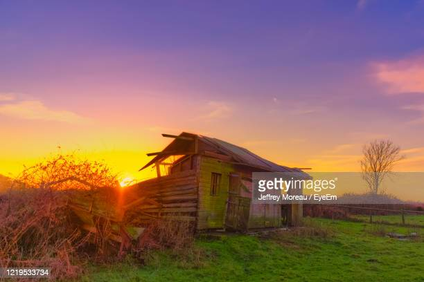 abandoned house on field against sky during sunset - south wales stock pictures, royalty-free photos & images