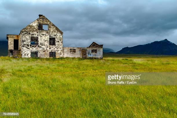 abandoned house on field against sky - abandoned stock pictures, royalty-free photos & images