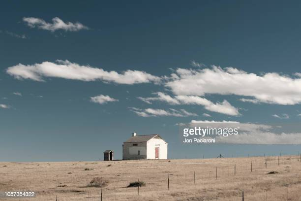 abandoned house on the horizon - simple living stock pictures, royalty-free photos & images