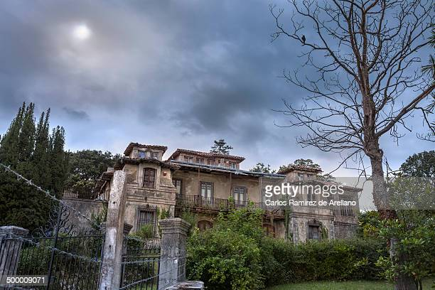 CONTENT] Abandoned house with garden in the moonlight and clouds with dark and mysterious atmosphere